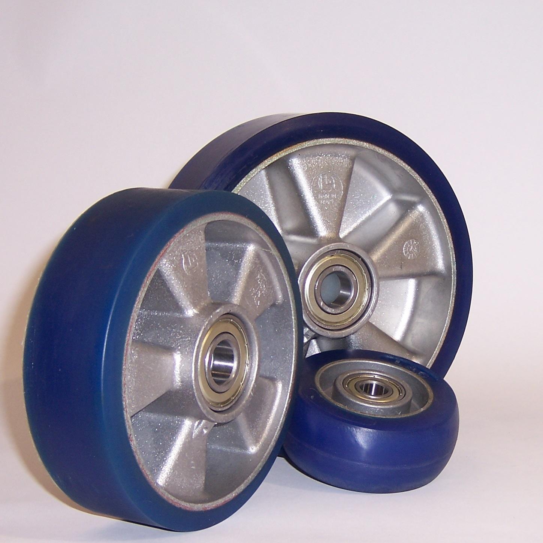 Ruote serie TS TAU SOFT - Ruote con battistrada in poliuretano colato soffice 87 Sh.A e mozzo in alluminio pressofuso; disponibile con cuscinetti a sfere o a rullini.